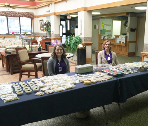 Niagara Hospice Hospicetality Advocates Lisa Kurilovitch and Kristin Human sell baked goods to raise funds for the gardens at Hospice at Jeanne's House.