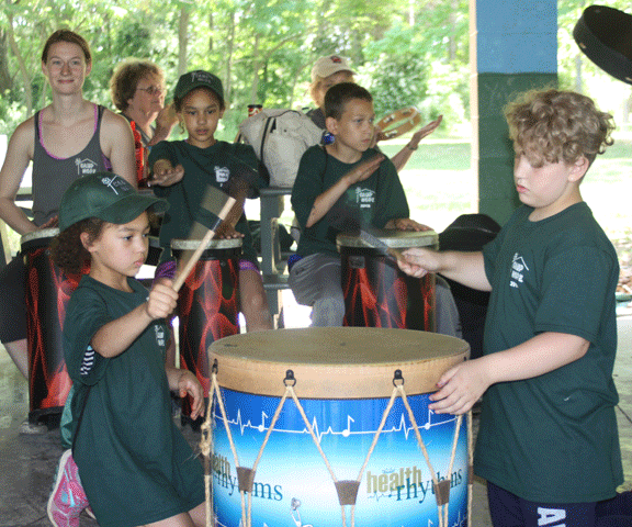 Campers enjoying the drumming circle.