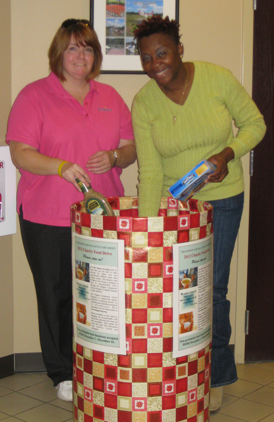 Niagara Hospice Nurse Katie Gannon and Hospice Aide Phoebe Pitts add to the HomeCare Partners Charity Drive barrel.