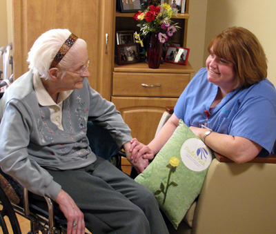 Niagara Hospice RN IKatie Gannon chats with one of her hospice patients at David's Path, a Niagara Hospice and Schoellkopf Health Center collaboration.