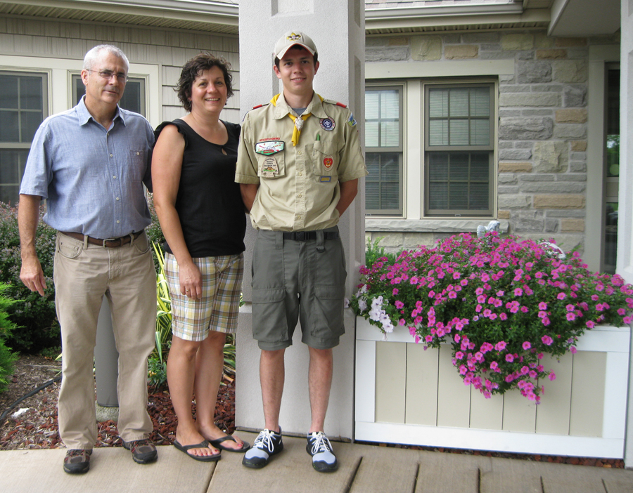 Eagle Scout candidate Steven Fournier, with his parents Carole and Joe Fournier, stand beside the two flower boxes he constructed to help meet requirements for rank of Eagle Scout.