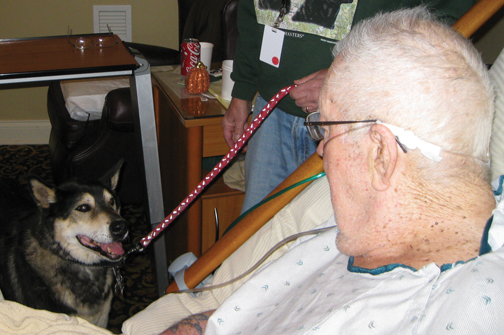 Niagara Hospice pet visit volunteer Prince enjoys a visit with Niagara Hospice House resident Glenn Greenwood with whom he has developed a special bond over the last nine months.
