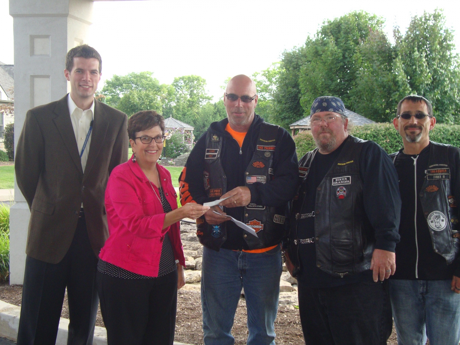 Pictured (right to left) are Eternal Brothers Motorcycle Club Treasurer Chris Bondi, Secretary Dan Rinker, Vice President Bill Ferro, Niagara Hospice Director of Clinical Services at Hospice House Janet M. Ligammari, and Director of Development Brendan McIntyre