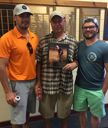 Holding a special photo of Frank Jr. who passed away in August of 2015 are his brothers and father. From L-R are Tom Tedesco, Frank Tedesco, Sr., and Joe Tedesco.