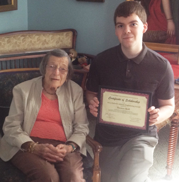 2015 Hallet B. Addoms Engineering Scholarship recipient Tom Stoll receives his certificate from Peggy Addoms.