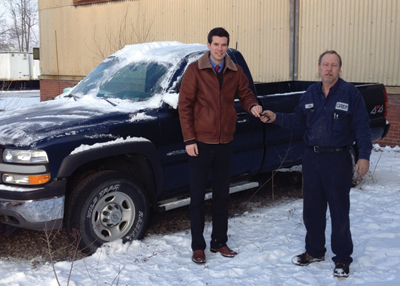 Niagara Hospice Alliance Director of Development Brendan McIntyre (left) receives keys to a donated Chevy pickup truck from Greif Plant electrician, Don Heim (right).