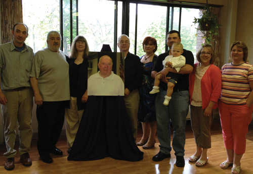 The family of David Winker gather around his portrait at the recent news conference announcing a dedicated hospice unit, David's Path, at Schoellkopf Health Center.